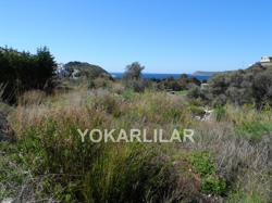 FOR SALE PLOT OF LAND IS NEAR FROM THE SEA LOCATED IN GUMUSLUK